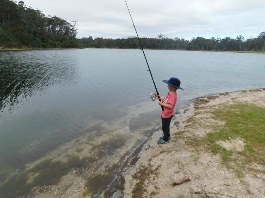 Cam fishing on banlk of Lake tyer