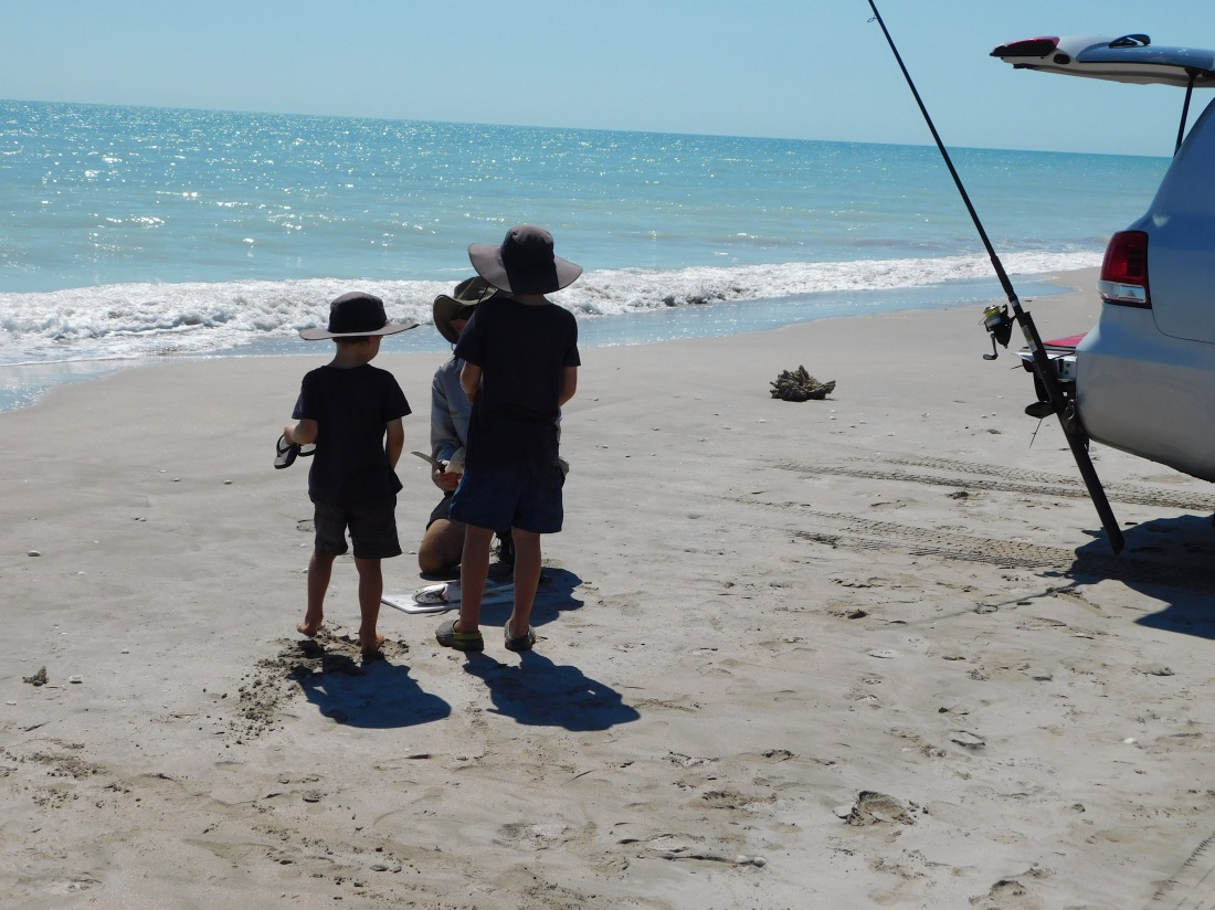80mile beach boys supervising fish filleting