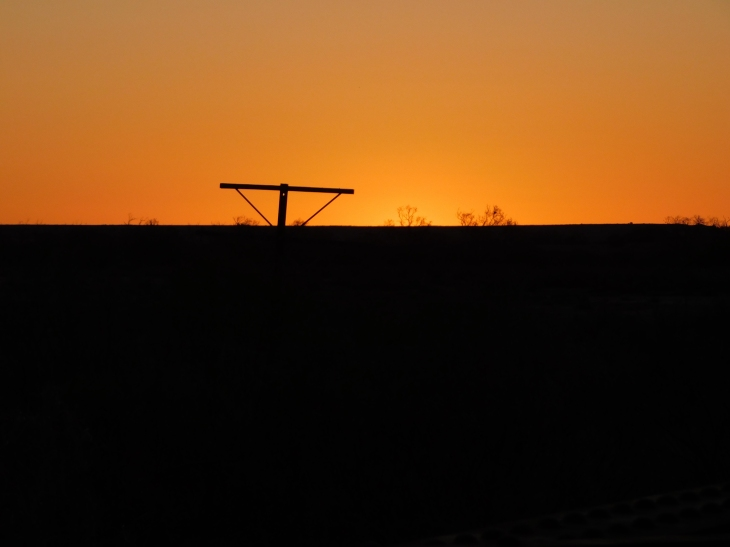 Lake Eyre South- old telegraph line sunset